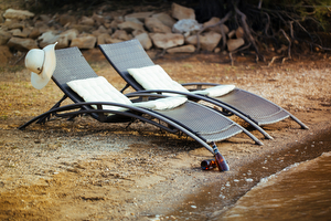 Sun chairs at the little beach in front of our finca